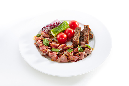 Thin Slices of Spicy Roast Beef with Fresh Vegetables Isolated on White Background. Restaurant Plate with Veal, Cucumbers, Cherry Tomatoes, Borodino Bread Toasts, Onion, Dijon Mustard Sauce, Greens Standard-Bild - 115864992