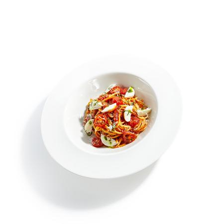 Classical Italian Spaghetti with Milk Mozzarella and Tomato Sauce Top View. Archivio Fotografico