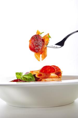 Italian Pasta with Salami, Cold Smoked Tomatoes, Onion, Garlic, Fresh Basil, Parsley, Sweet Chili Sauce, Bulgarian Pepper Close Up. Reklamní fotografie