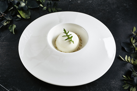 Exquisite Serving Restaurant Plate of White Parmesan Sphere with Black Angus Tartare Top View.