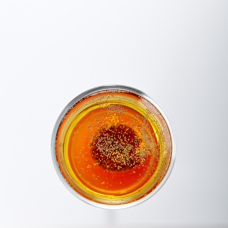 Bellini Cocktail with Prosecco Sparkling Wine and Peach Puree or Nectar Isolated on White