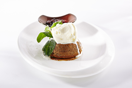 Yummy Chocolate Flan with Ice Cream and Jam on Elegant Restaurant Plate Isolated on White