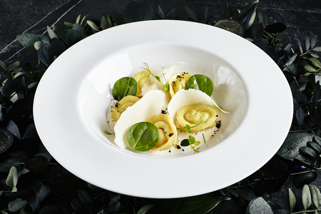 Exquisite Serving White Restaurant Plate of Homemade Crab Dumplings with Sour Cream Sauce and Black Truffle.