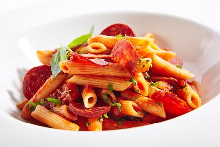 Italian Pasta with Salami, Cold Smoked Tomatoes, Onion, Garlic, Fresh Basil, Parsley, Sweet Chili Sauce, Bulgarian Pepper Close Up