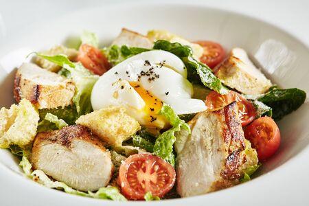 White Restaurant Plate of Caesar Salad