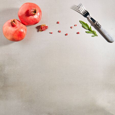 Ripe fresh pomegranate fruits and seeds with copy space. Stock Photo