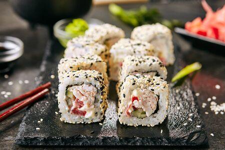 Macro shot of chicken uramaki sushi with bacon 写真素材