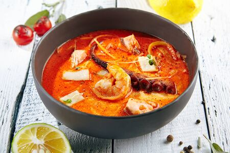 Restaurant Soup Food - Traditional Thai Tom Yam Kung Soup or Tom Yum Kong. Stock Photo
