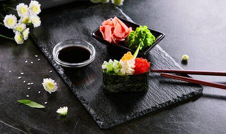 Delicious gunkan with cucumber and masago caviar.