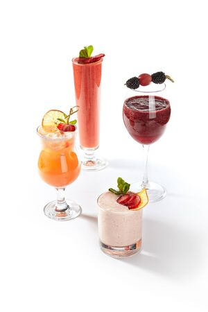 Collection of non-alcoholic drinks with citrus cocktail, strawberry yogurt smoothie and berry smoothie isolated on white background. Set of various fresh fruit cold drinks or vitamin detox cocktails Foto de archivo - 130171101