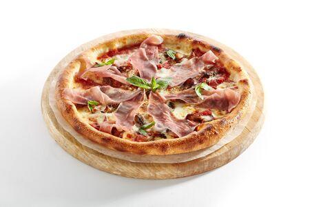 Pizza with Parma Ham, Porcini Mushrooms, Mozzarella Cheese, Fresh Basil, Cherry Tomatoes, Pesto and Tomato Sauce Isolated on White Background. Traditional Italian Whole Flatbread on Wood Close Up