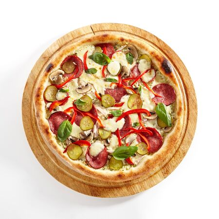 Creamy Pizza with Cervelat, Tartar Sauce, Chicken Fillet, Sliced Mushrooms, Sweet Pepper, Salted Cucumbers and Mozzarella Cheese Isolated on White Background. Traditional Italian Flatbread Top View