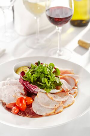 Gourmet, restaurant, delicious dinner food - close up of Sliced Meats with Rocket Salad and Tomatoes 写真素材