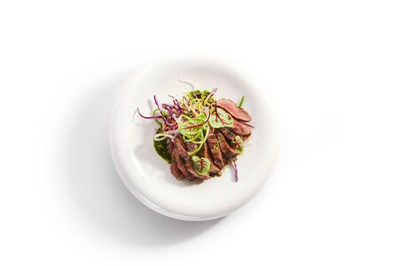 Tataki roast beef top view. Tasty grilled meat with onion and greenery. National cuisine, traditional asian recipe. Japanese culinary method. Delicious meal with sauce and seasonings Reklamní fotografie