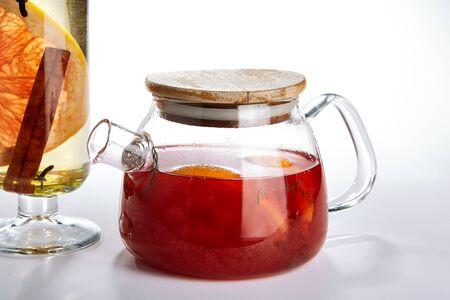 Tea pot. Winter season beverage on white background.