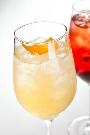 Peach Spritz cocktail. Alcohol soft drink in glass side view. Refreshment beverage with fruit puree in drinkware. Exotic summer beach cocktail portions with crushed ice in glassware