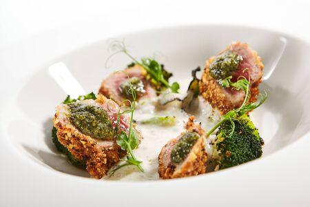 Tuna in crispy breading close up. Imagens