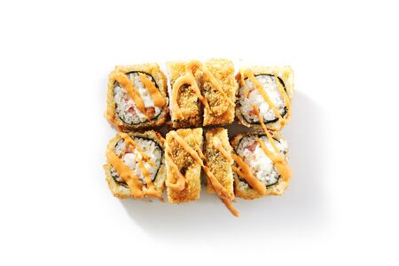 Shrimp rolls with cream cheese, tomatoes and Spicy sauce on white background top view. Tasty sushi, asian cuisine meal, rice dish close up. Traditional japanese food, delicious sashimi