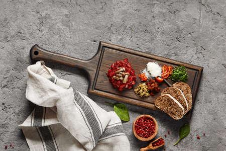 Beef tartare on wooden plate. Restaurant appetizer. Gourmet food Imagens