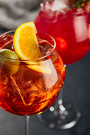 Classic cocktail. cocktail on dark background. Fresh orange drink. Festive christmas background.