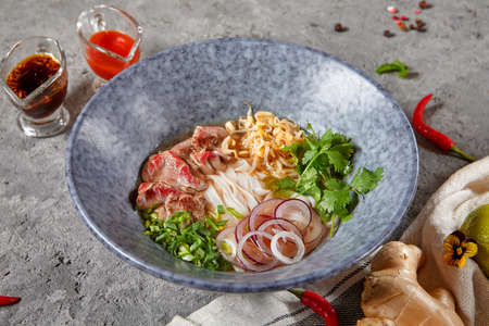 Vietnamese Cuisine - Beef Pho Noodle Soup or Pho Bo Soup. Stock Photo