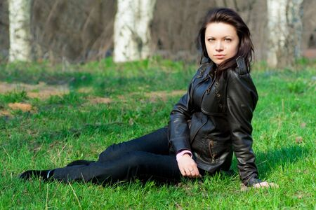 girl in leather jacket lying on the grass Stock Photo - 8591366