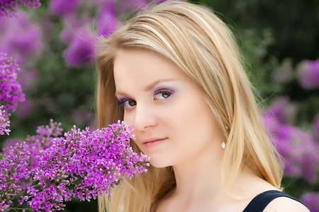 blonde girl near the lilacs Stock Photo - 8591304