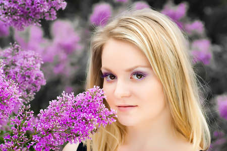 blonde girl near the lilacs Stock Photo - 8591344