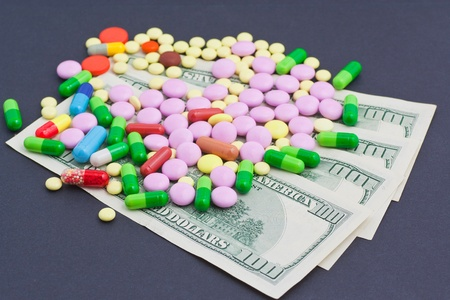 Medicines costs money. Drugs and dollars photo