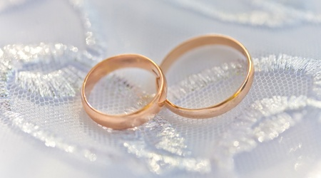 Wedding rings on a satiny fabric Stock Photo - 9357556