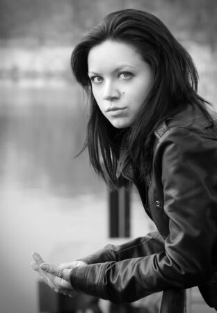 girl on an iron bridge looks in the frame in black and white Stock Photo - 10129575