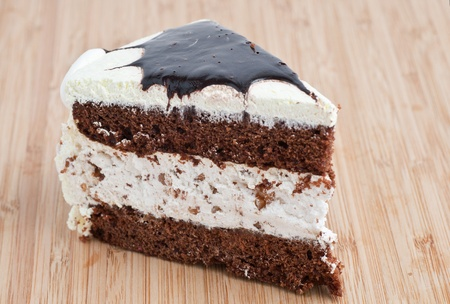 Tasty Chocolate Cake Slice on a wooden board photo