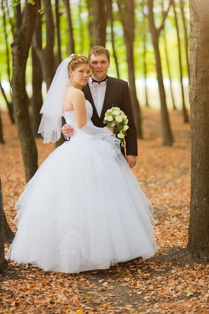 Romantic wedding couple having fun together outdoor in nature photo