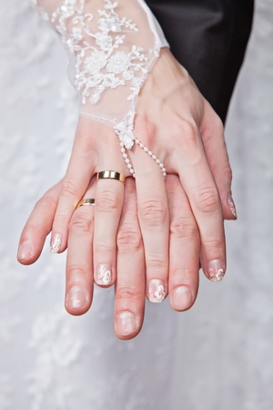 Wedding details - closeup of hands of newly-married with gold rings Stock Photo - 12538982