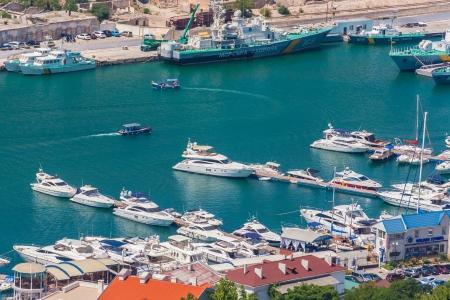 Bird-eye view of Balaklava bay with yachts and small ships, Crimea, Ukraine