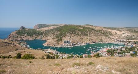 Bird-eye view of Balaklava bay with yachts and small ships, Crimea, Ukraine photo