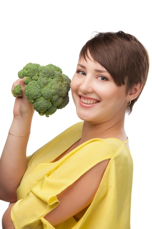 Portrait of a beautiful smiling woman with broccoli, isolated on white photo