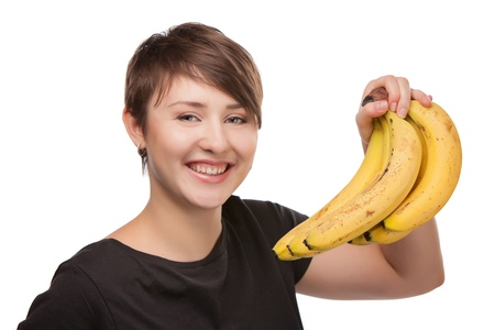 portrait of attractive smiling woman isolated on white studio shot with banana photo