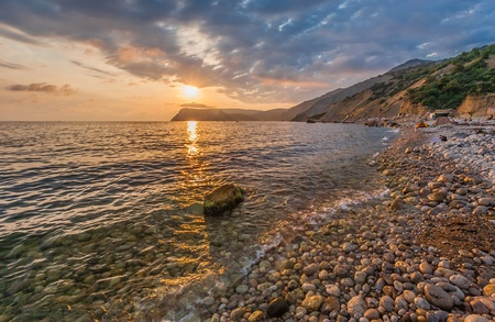 Beautiful mountain seaside at sunset  (Inzhir reserve, Crimea, Ukraine) photo