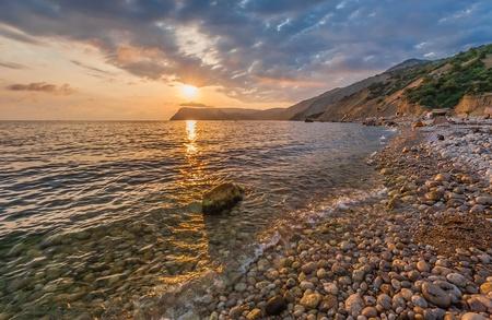 Beautiful mountain seaside at sunset  (