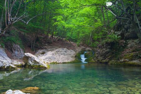 Mountain river with nice waterfall, Crimea, Ukraine photo