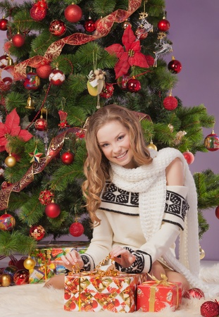 Girl with gift boxes near christmas tree Stock Photo - 17008836