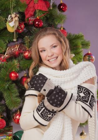 Beautiful woman hanging toy on Christmas tree Stock Photo - 17508302