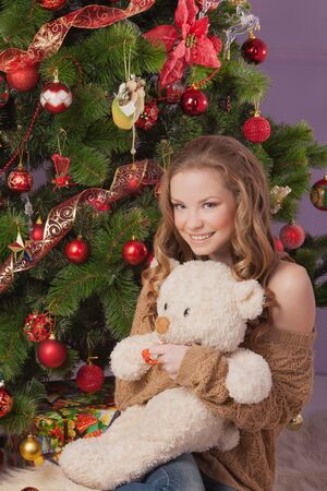 The girl with a soft toy dreams of a gift Stock Photo - 17008818