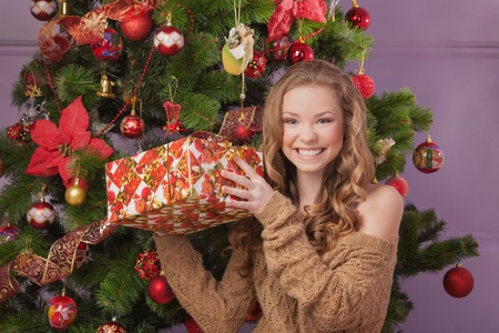 Girl with gift boxes near christmas tree Stock Photo - 17008816
