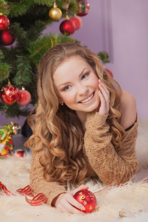 Beautiful woman hanging toy on Christmas tree Stock Photo - 17008866