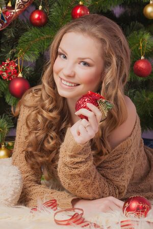 Beautiful woman hanging toy on Christmas tree Stock Photo - 17008834