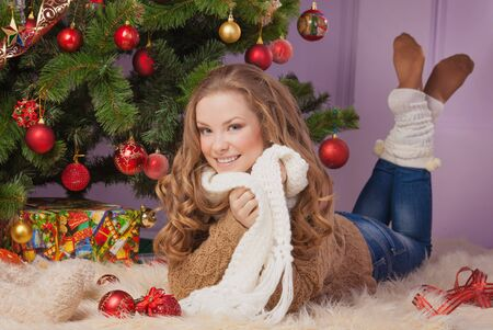 Beautiful woman hanging toy on Christmas tree Stock Photo - 17008855