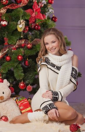 Girl with gift boxes near christmas tree Stock Photo - 17008854