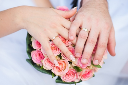 Hands and rings it is beautiful wedding bouquet photo